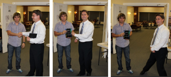 Tournament organizer Hughey awarding Bruzon first prize while doing what looks like some TANGO moves.