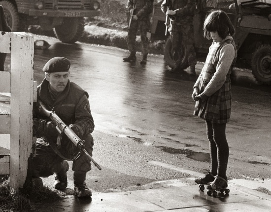 Girl looks on at British Soldier in Ireland_ January, 1972