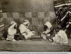 And old photo from the 19th century. http://www.artvalue.com/auctionresult--moulin-felix-jacques-antoine-1-la-partie-d-echecs-oran-chess-2787831.htm