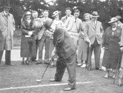 Lasker playing golf.
