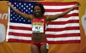 Mar 18, 2016; Portland, OR, USA; Nia Ali (USA) poses with United States flag after winning the womens 60m hurdles during the 2016 IAAF World Championships in Athletics at the Oregon Convention Center. Mandatory Credit: Kirby Lee-USA TODAY Sports